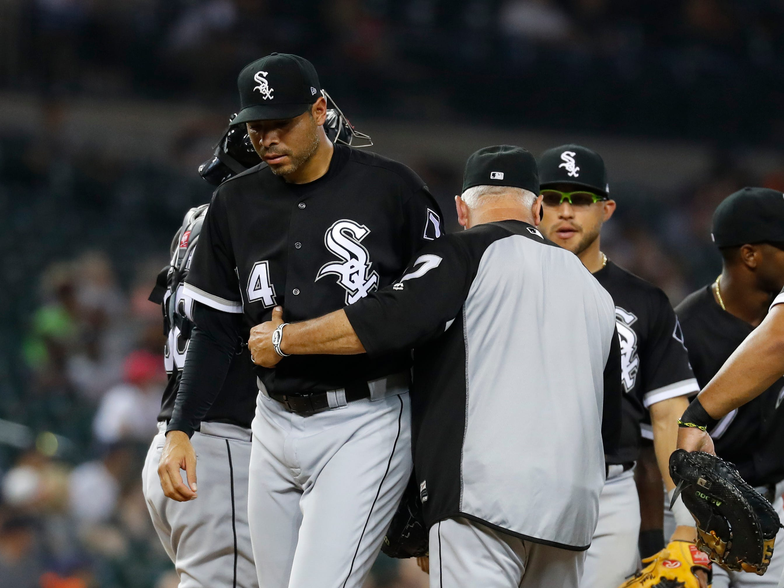 Chicago White Sox manager Rick Renteria takes the ball from relief pitcher Jeanmar Gomez in the seventh inning.