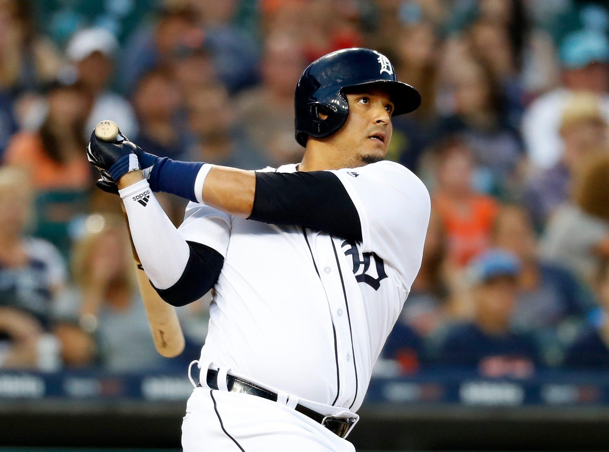Detroit Tigers' Victor Martinez doubles in the fourth inning.