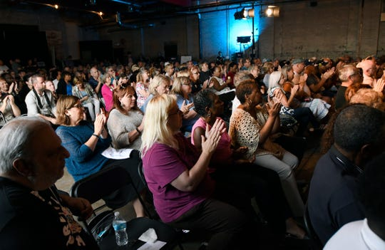 More than 300 people cheer  on Tom Steyer as he addresses them from stage, Monday in Detroit.  Steyer is campaigning to have people sign his petition to impeach President Donald Trump.
