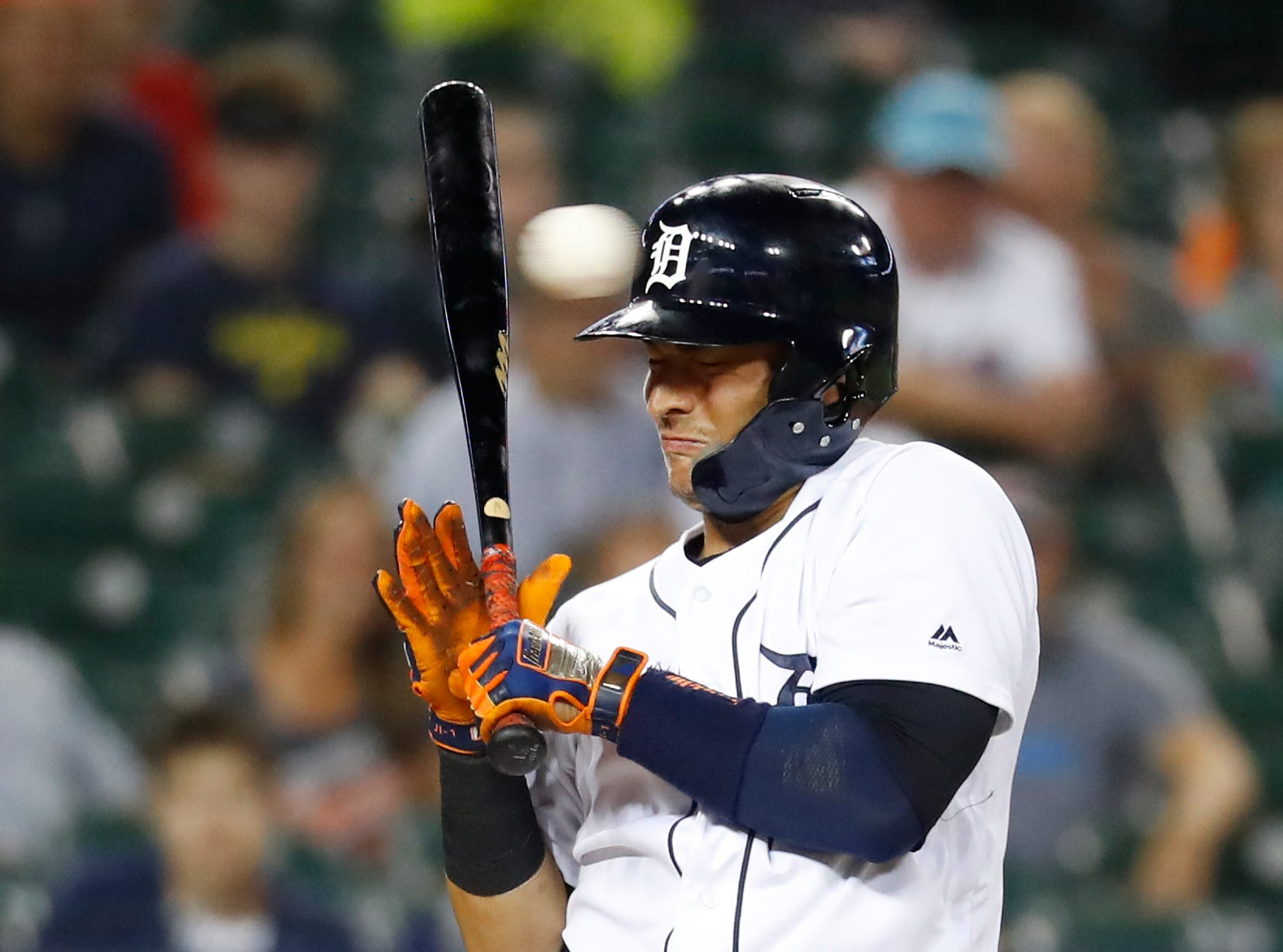 Detroit Tigers' Jose Iglesias reacts to an inside pitch in the eighth inning.