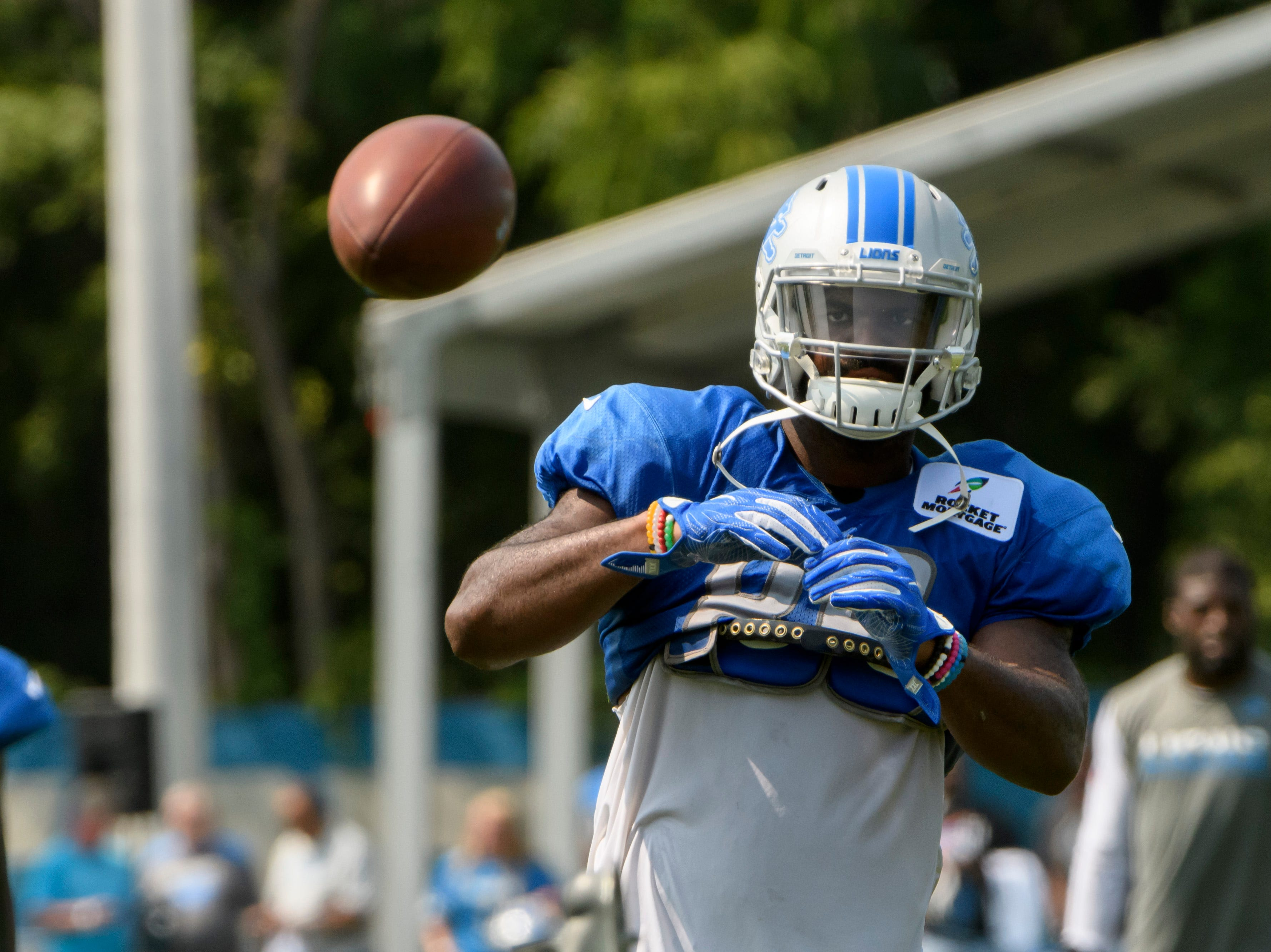 Detroit Lion tight end Marcus Lucas catches the ball during practice.