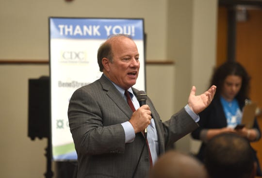 Detroit Mayor Mike Duggan speaks about the Detroit Land Bank Authority's Buy Back Program at the Northwest Community Center Tuesday.