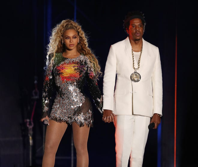 Beyonce and Jay-Z perform during the 'On The Run II' tour at Ford Field on Monday.