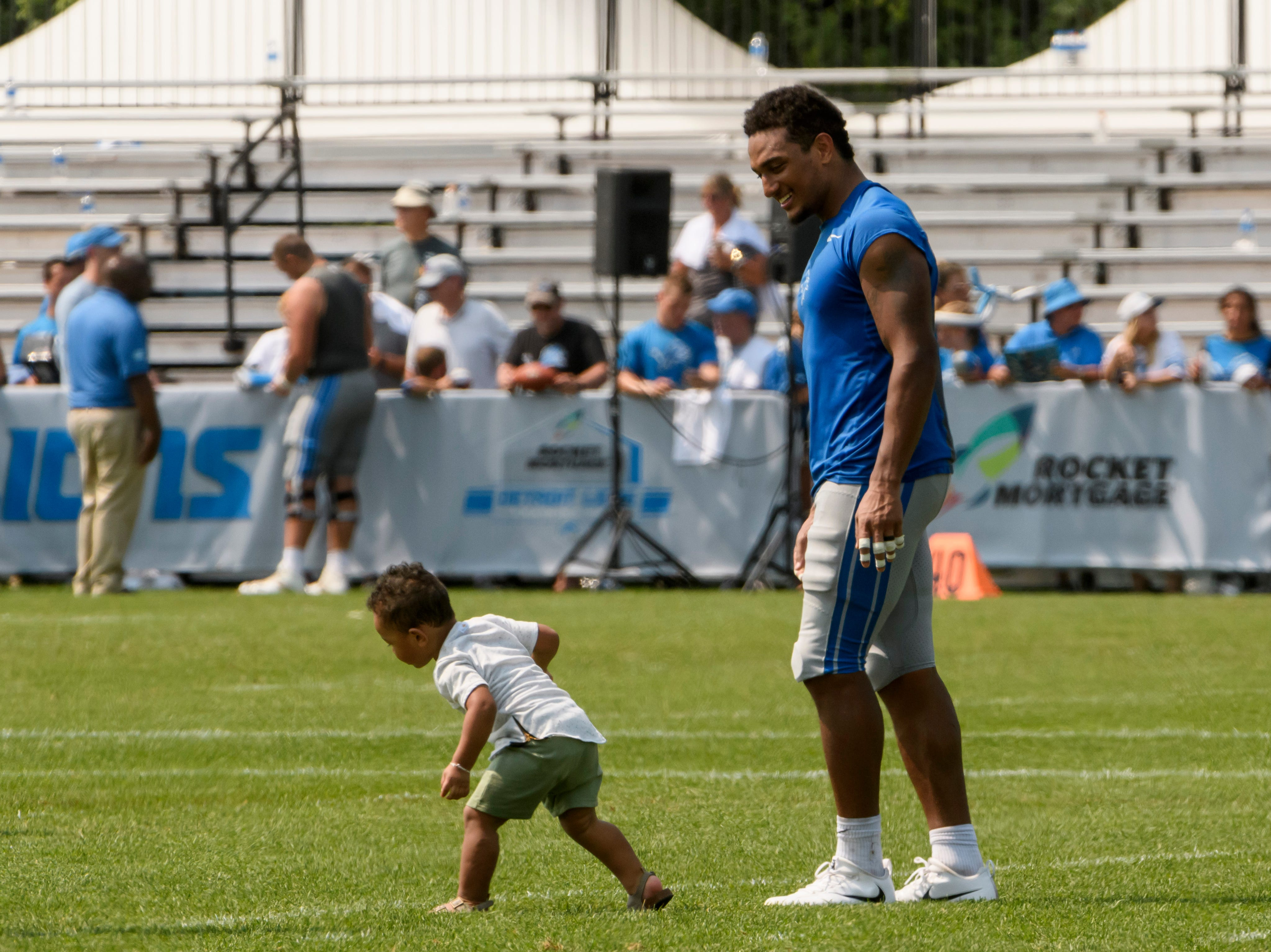 Some of the players and their children ran around on the field after practice.