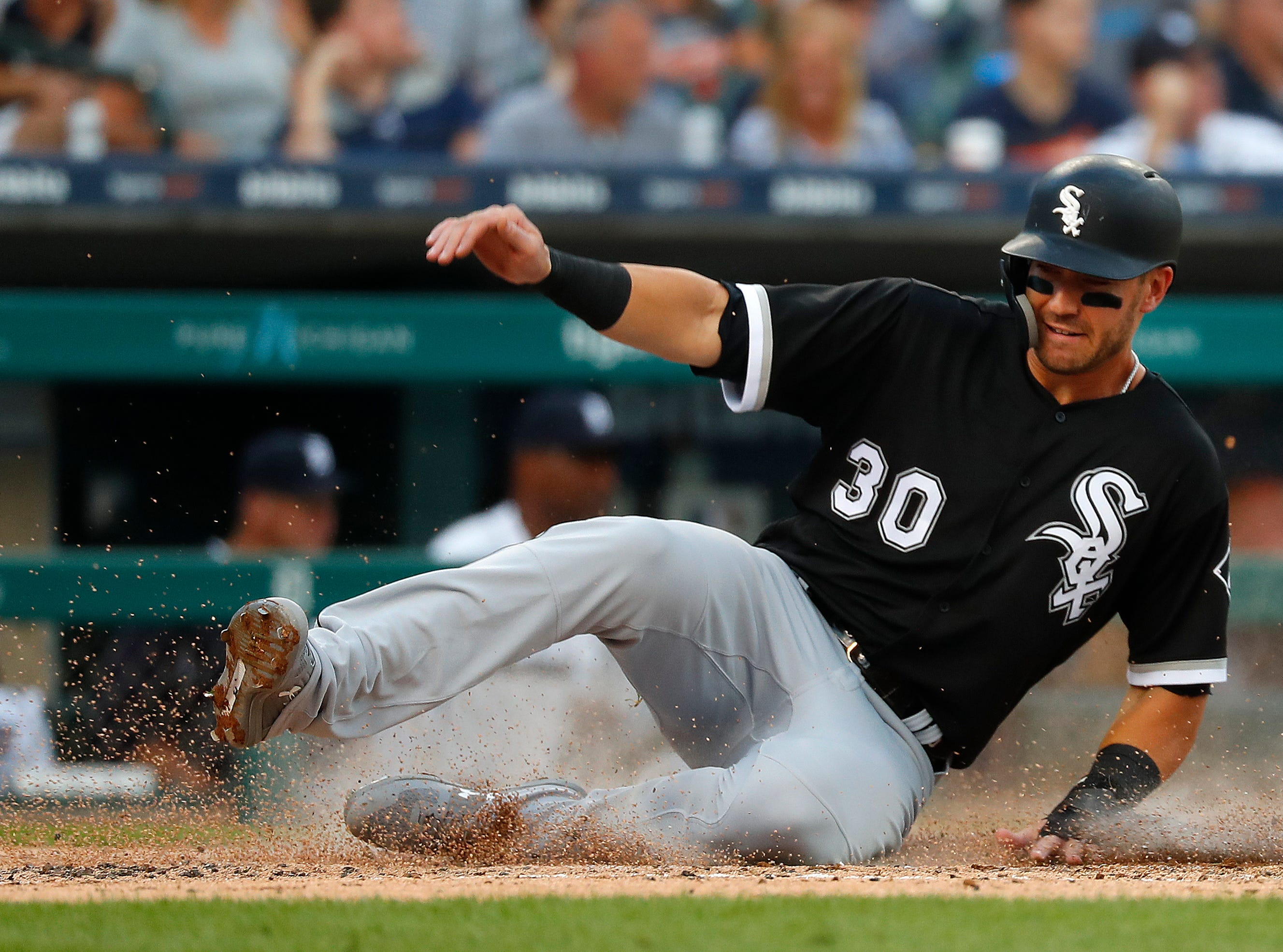 Chicago White Sox's Nicky Delmonico scores in the third inning.