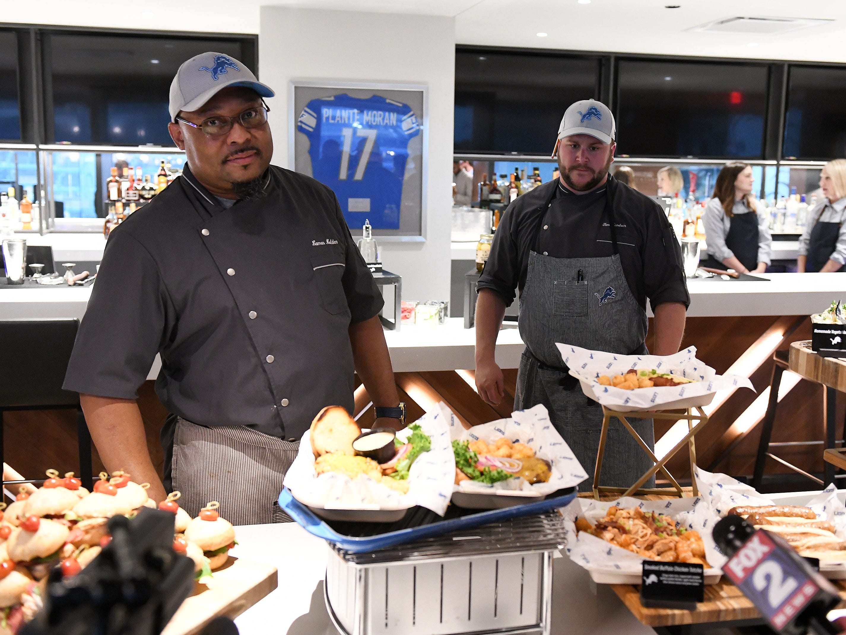 Senior executive chef Lamar Nolden, left, and executive sous chef Tim Hendren show off the new food and concession choices at Ford Field in Detroit.