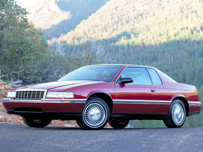 The bigger, bolder, 1992 Cadillac Eldorado, left, and Seville marked a return to form after years of shrinking Caddies — and shrinking market share. Motor Trend awarded it Car of the Year.