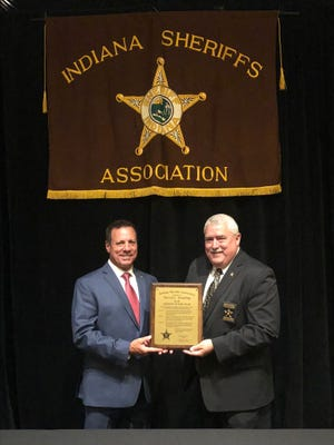 Vanderburgh County Sheriff Dave Wedding (left) was presented the Sheriff of the Year award this year as chosen by the Indiana Sheriff's Association. Posey County Sheriff Greg Oeth, who was named the Sheriff of the Year last year, gave Wedding the plaque at the ISA's Summer Conference last week.