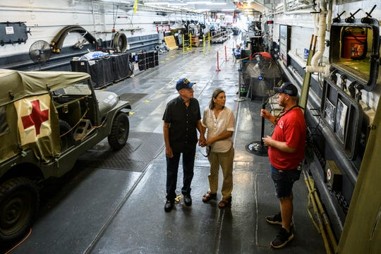 James Homan, from left, and Belen Dorsett of Tell City, Ind., receive a tour from Brady Bolinger in the tank deck of the USS LST-325, Tuesday morning, Aug. 14, 2018. On Monday night, Evansville City Council approved nearly $2.8 million to relocate the ship from Marina Pointe to Downtown Evansville.