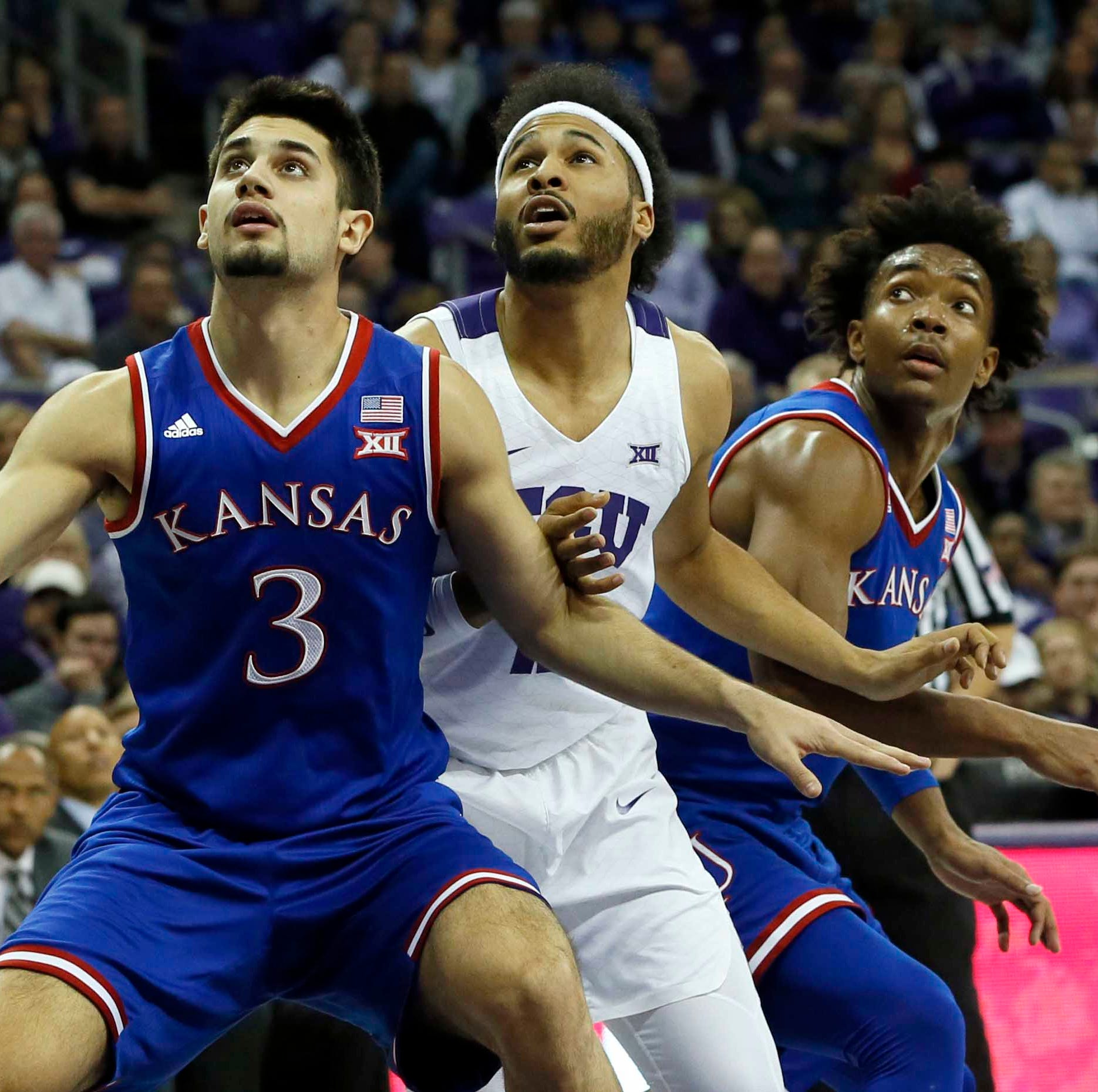 Jan 6, 2018; Fort Worth, TX, USA; Kansas Jayhawks guard Sam Cunliffe (3) and guard Devonte' Graham (4) fight for position against TCU Horned Frogs guard Shawn Olden (2) in the first half at Ed and Rae Schollmaier Arena.