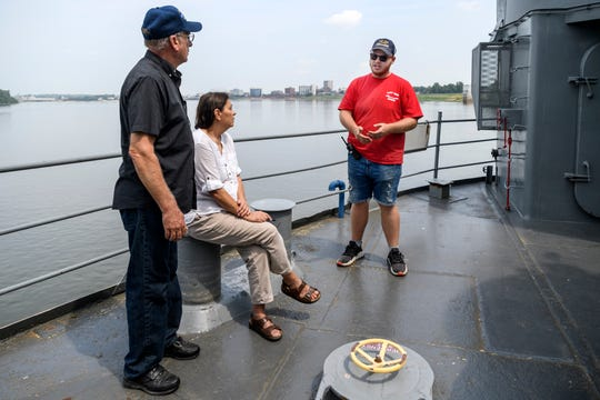 James Homan, from left, and Belen Dorsett of Tell City, Ind., listen to their tour guide Brady Bolinger give animated facts about the USS LST-325 in Evansville, Ind., Tuesday, Aug. 14, 2018. On Monday night, Evansville City Council approved nearly $2.8 million to relocate the ship from Marina Pointe to Downtown Evansville.