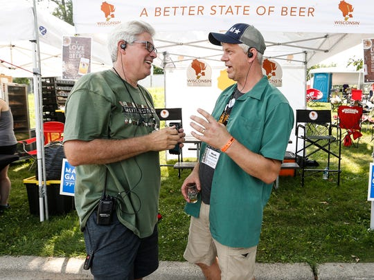 Great Taste of the Midwest Brewer Liaison Fred Swanson and Great Taste Assistant to the Chairman Mark Garthwaite talk Saturday, August 11, 2018, in Olin Park in Madison during the Great Taste of the Midwest beer tasting event.