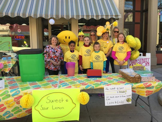 Julie Day-Willey's full-time teaching career often intersects with her shop, such as when Chegwin students host their Lemonade Day stand in front of her store.