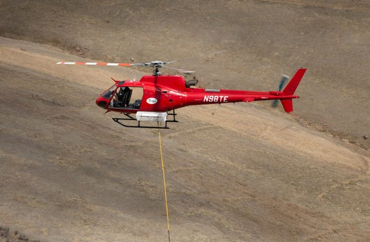 An AS350 B2/B3 in flight. This helicopter is stationed at Northern Colorado Regional Airport and is owned by Trans Aero Ltd.