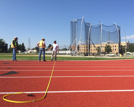Workers put the finishing touches on CSU's $2.4 million renovation of Jack Christiansen Memorial Track last summer. The facility will host its first meet since the renovations this week, with the Glenn Morris Multi-Events Competition on Thursday and Friday and the Fum McGraw Invitational on Friday and Saturday.