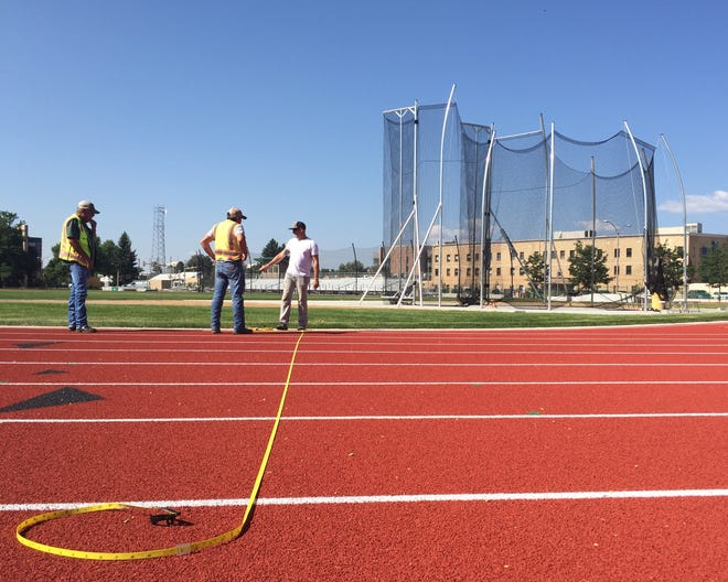 Workers put the finishing touches on CSU's $2.4 million renovation of  Jack Christiansen Memorial Track on Wednesday.