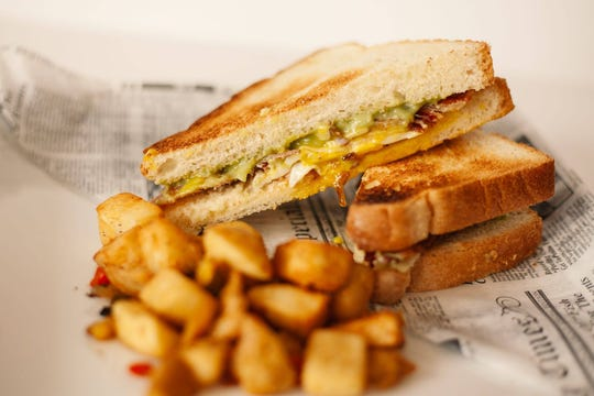 Dad's Breakfast Sandwich from Artisan Eatery in south Fort Myers, is made with a local egg, avocado, bacon and aged cheddar on toasted white bread.