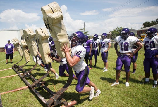 Cypress Lake High School football player Liam Ball, right, practices on Monday 8/13/2018.