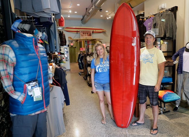 Mike and Jill Miller, owners of EOS Surf & Outdoor Shop stand in their downtown Sheboygan store on July 31.