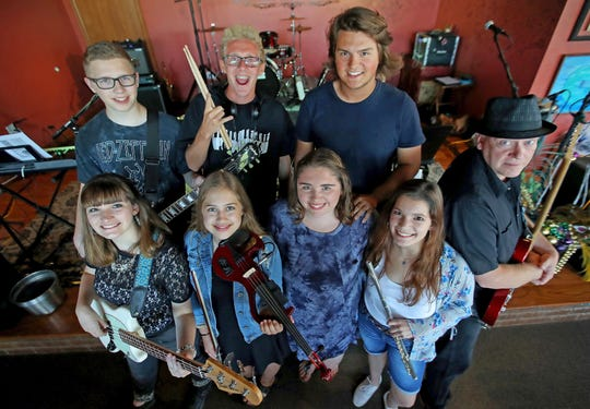 Third Degree pictured before a gig July 26 at The Blue Opus in Bellevue. Front from left are Hannah Swan, Kate Stenson, Rhean Krueger, Sarah Swan. Back row are Presley Christman, Nick May, Logan Zills and Bernie Rocheleau.
