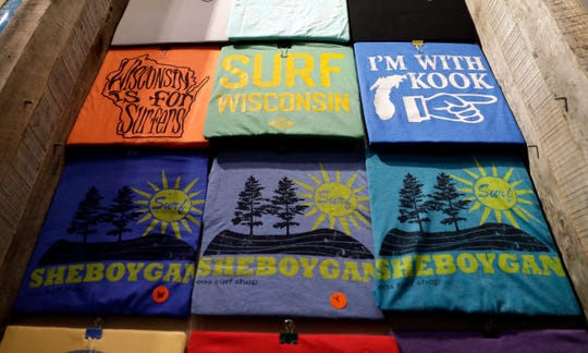 Surfing-themed T-shirts are available for purchase at EOS Surf & Outdoor Shop in downtown Sheboygan.