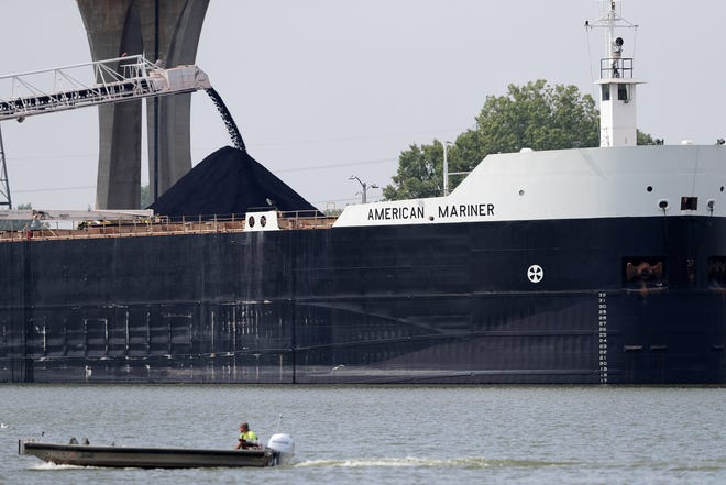 The American Mariner unloads coal on Tuesday in Green Bay. The Army Corps of Engineers will start dredging the shipping channel in Green Bay so that cargo ships safely navigate to docks along the Fox River.