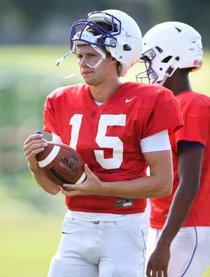 Furman quarterback Harris Roberts works out with his team during practice Tuesday, August 14, 2018. Roberts will play in the Paladins season opener against Clemson, the school he recently enrolled in.