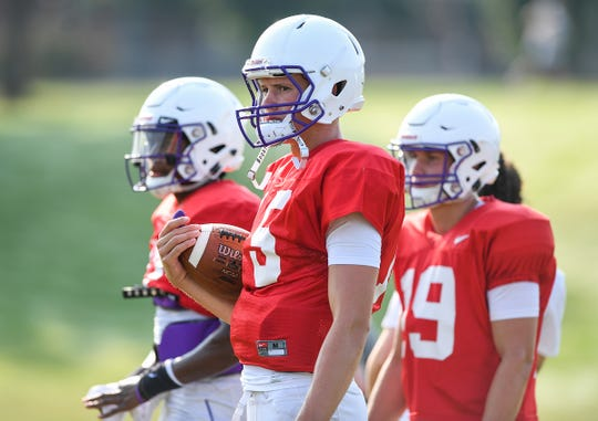 Furman quarterback Harris Roberts (15) works out with the Paladins' other quarterbacks during a mid-August practice. Roberts will start in the Paladins season opener against No. 2-ranked Clemson.