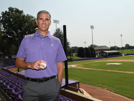 Furman athletic director Mike Buddie wears his New York Yankees 1998 World Series championship ring and while holding a Yankees signed ball Tuesday, August 14, 2018 at Furman. Buddie was a pitcher on the Yankees '98 World Series Champion team.