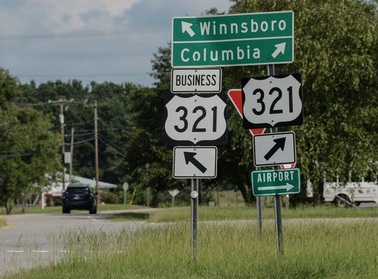 A car drives into Winnsboro along state highway 321 business.