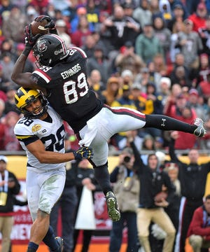 South Carolina wide receiver Bryan Edwards (89) makes a catch for a touchdown over Michigan's Brandon Watson (28) in the 2018 Outback Bowl. Edwards caught only one pass of longer than 40 yards last year.