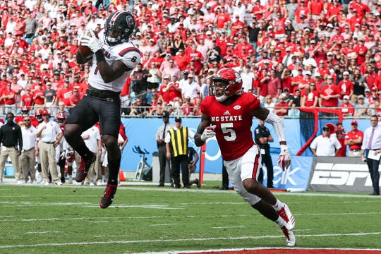 South Carolina receiver Deebo Samuel (1) leaps for the touchdown over N.C. State cornerback Johnathan Alston (5) in 2018.  Samuel averaged 16.7 yards per catch last year before suffering a season-ending injury in the third game.