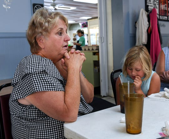 Ann Price, left, of Lake Wateree, sitting near her granddaughter Lily Rawls of Blythewood, expresses concern over businesses coming and going for short periods of time in Winnsboro, during her visit to the Barn Xpress cafeteria in Winnsboro on Monday.