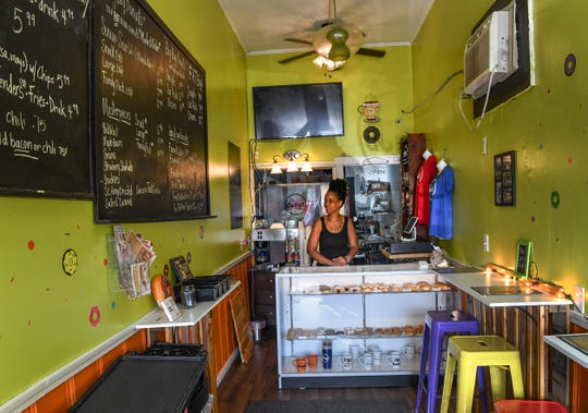 """Crystal and Shaun Paulk own The Donut Guy shop, a tiny space along South Congress Street in the heart of downtown Winnsboro. """"What's going to happen to them, that's bigger than who's going to buy my next donut,"""" Crystal Paulk said."""