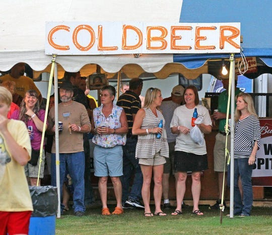 A crowd listens to the music from About a Girl from the cold beer tent during the Spittoono Festival last year