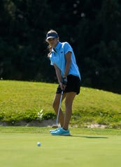Great Falls High's Kelly Jones putts during the second round of the Great Falls Invite Golf Tournament at Eagle Falls Golf Course on Tuesday.