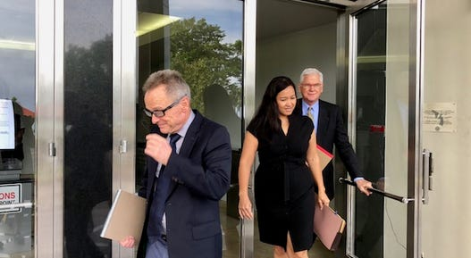 Lawyers for plaintiffs and defendants in Guam's clergy sex abuse cases emerge from the U.S. District Court building after Aug. 14, 2018's joint status conference. Lawyers for most of the plaintiffs told judges they are considering withdrawing from the planned mediation in September because the Archdiocese of Agana did not inform them beforehand of its recent selling of three properties and the imminent selling of the former Accion Hotel, which they said could help satisfy plaintiffs' claims instead of just relying on insurance money.