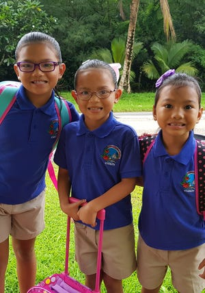Armani Taijeron, 8, third grade, Daisy Taijeron, 7, second grade and Daiani Taijeron, 5, Kindergarten. All students of Inarajan Elementary School, Home of the Chiefs.
