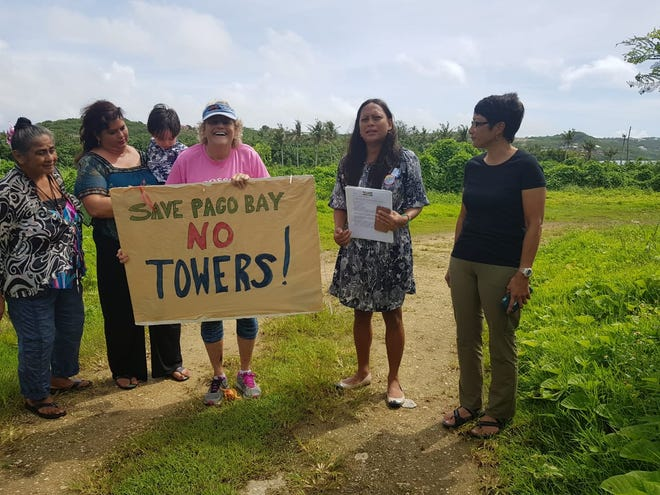 Members of Save Southern Guam held a press conference at the site of a controversial Pago Bay development Tuesday. The group will celebrate the project being halted by the Guam Land Use Commission during a wave Thursday at the Pago Bay bridge.