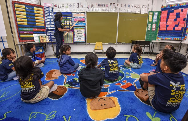 Teacher JoAnn Brown engages in a days of the week exercise with her kindergarten students during their first day of class at Agana Heights Elementary School on Tuesday, Aug. 14, 2018.