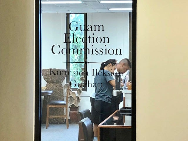 In this file photo, people in the Guam Election Commission office register to vote.