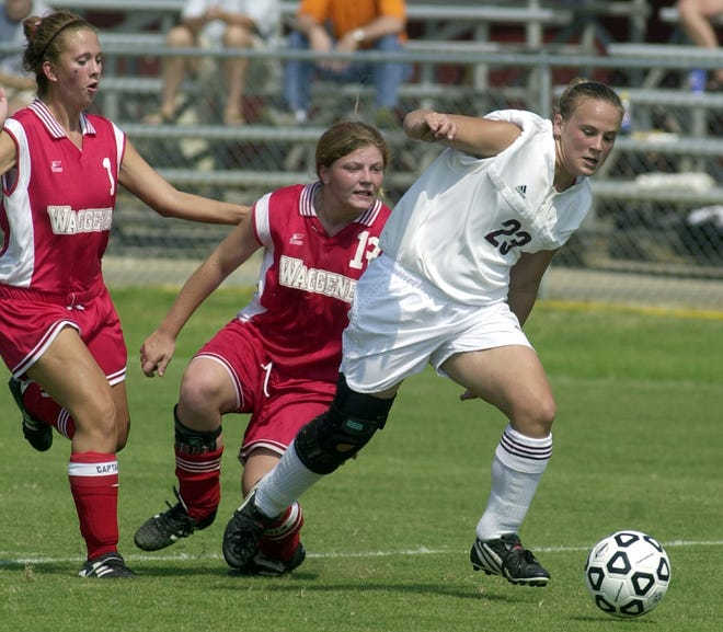 Katie Overton, who is shown playing against Louisville Waggener during the 2002 season, is one of the inductees in the 2018 class of the Henderson County Sports Hall of Fame.