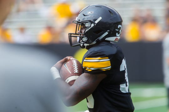 Iowa running back Henry Geil rushes during a Kids Day practice on Saturday, Aug. 11, 2018, at Kinnick Stadium in Iowa City.