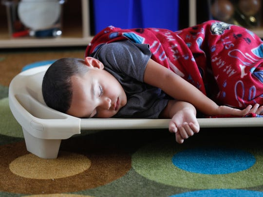Josiah Shockley rests during nap time at in the REACH Early Learning Center located inside the Fletcher Place Community Center in Indianapolis on Friday, Aug. 10, 2018. REACH stands for Renewal, Empowerment, Achievement, Compassion, and Hope.