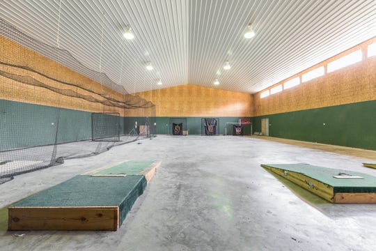 Sitting on this property's 5.98 acres of green land is a 4,800-square-feet sports barn.