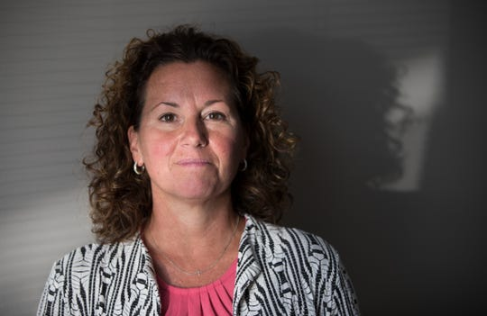 Shelly Fitzgerald poses for a photo during an interview surrounding Fitzgerald being placed on administrative leave as a counselor at Roncalli High School, Tuesday, Aug. 14, 2018. An unknown person voiced concern about Fitzgerald's sexual orientation, prompting a chain of events that resulted to the disciplinary action by the Catholic school.