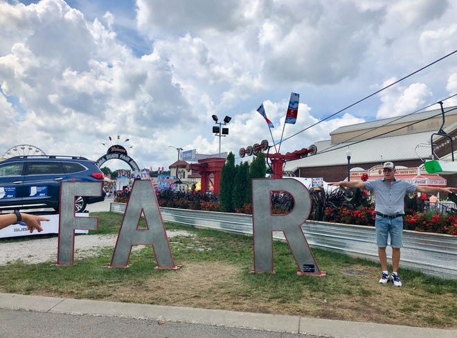 Gordon Amos puts his own spin on the giant letters at the Indiana State Fair.