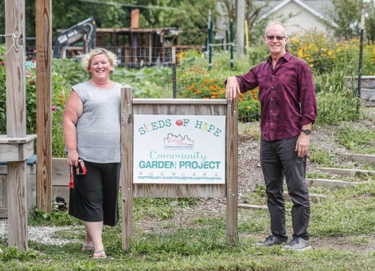 Melissa Drew, Executive Director, and Randy Sorrell, Chairman of the Board for Fletcher Place Community Center in Indianapolis, stand outside the 'Seeds of Hope Community Garden Project' outside the Community Center in Indianapolis on Friday, Aug. 10, 2018. The garden is tended to by volunteers and offers education for those interested in growing their own gardens.