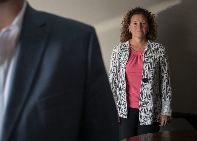 Shelly Fitzgerald and her lawyer David Page pose for a photo during an interview surrounding Fitzgerald being placed on administrative leave as a counselor at Roncalli High School, Tuesday, Aug. 14, 2018. An unknown person voiced concern about Fitzgerald's sexual orientation, prompting a chain of events that resulted to the disciplinary action by the Catholic school.