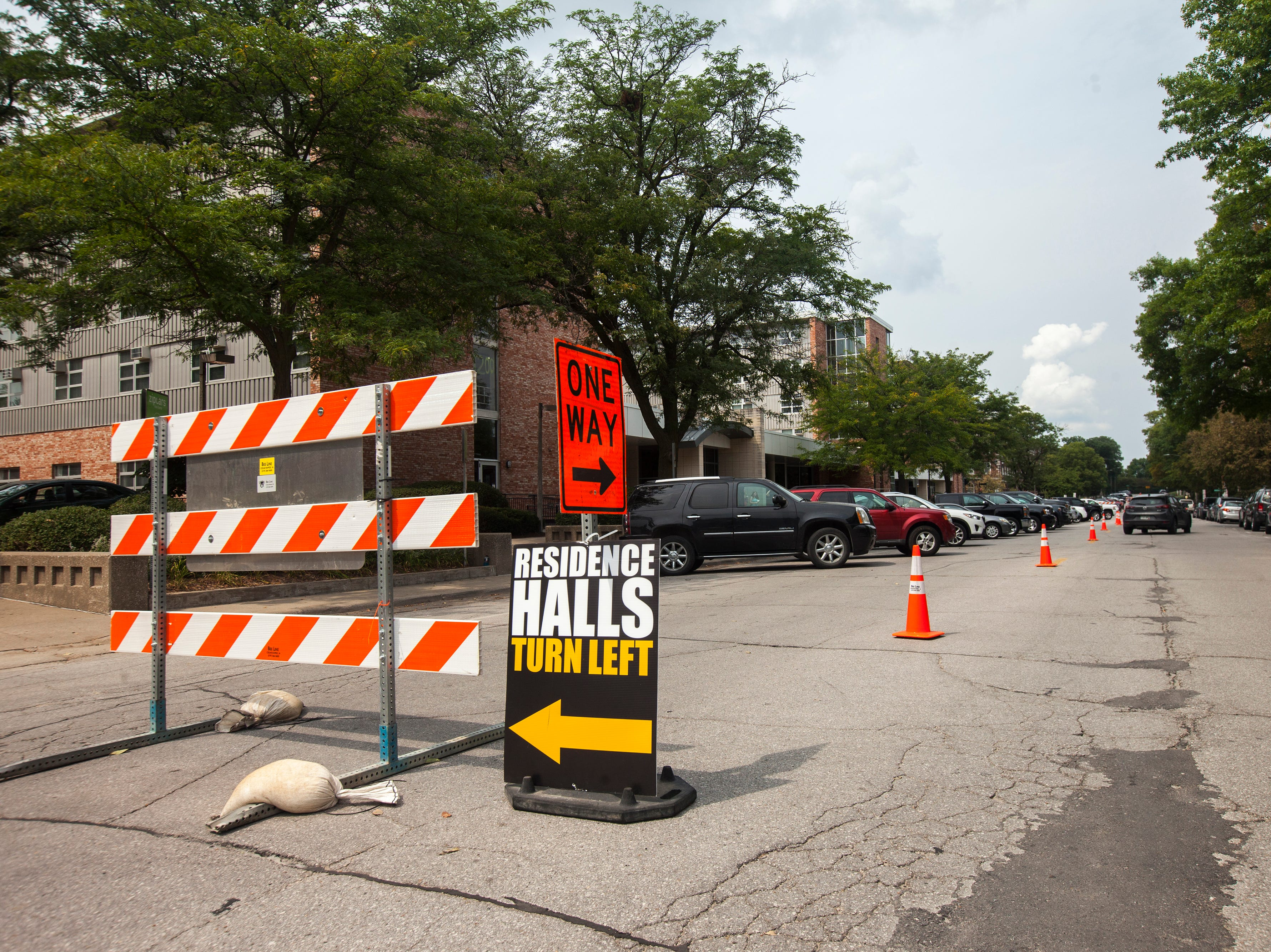 Traffic cones line Clinton Street during new student move-in on Tuesday, Aug. 14, 2018, on the University of Iowa campus in Iowa City. Tuesday was the first day for new students on campus to move into their residence halls.